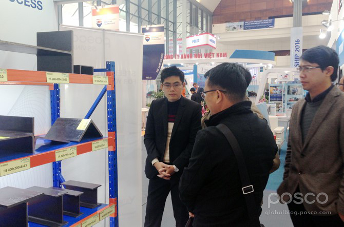 Customers at the POSCO booth admire POSCO SS VINA's shape steel products.