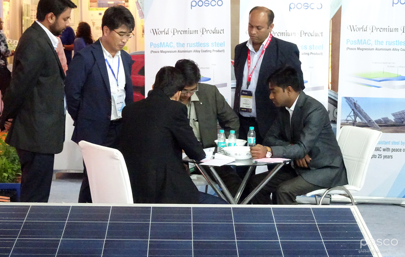 POSCO-India officials interact with visitors during the 2016 REI expo.