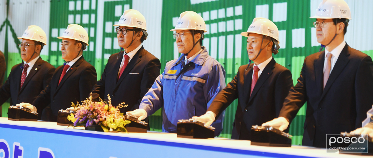 POSCO CEO Ohjoon Kwon and partners all stand ready to press the button to bring the plant online.