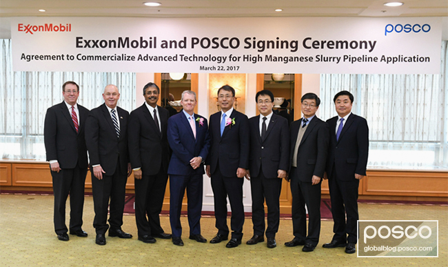 POSCO and ExxonMobil employees can be seen posing for a commemorative photo shoot after inking a high manganese steel supply contract at the POSCO Center.