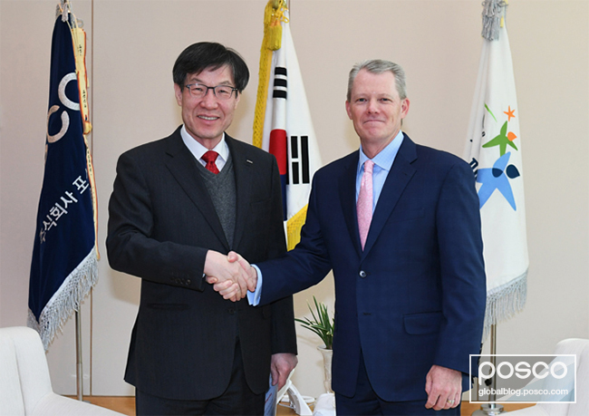 POSCO CEO Ohjoon Kwon and Tom Schuessler, president of ExxonMobil Upstream Research Company, pose for a picture