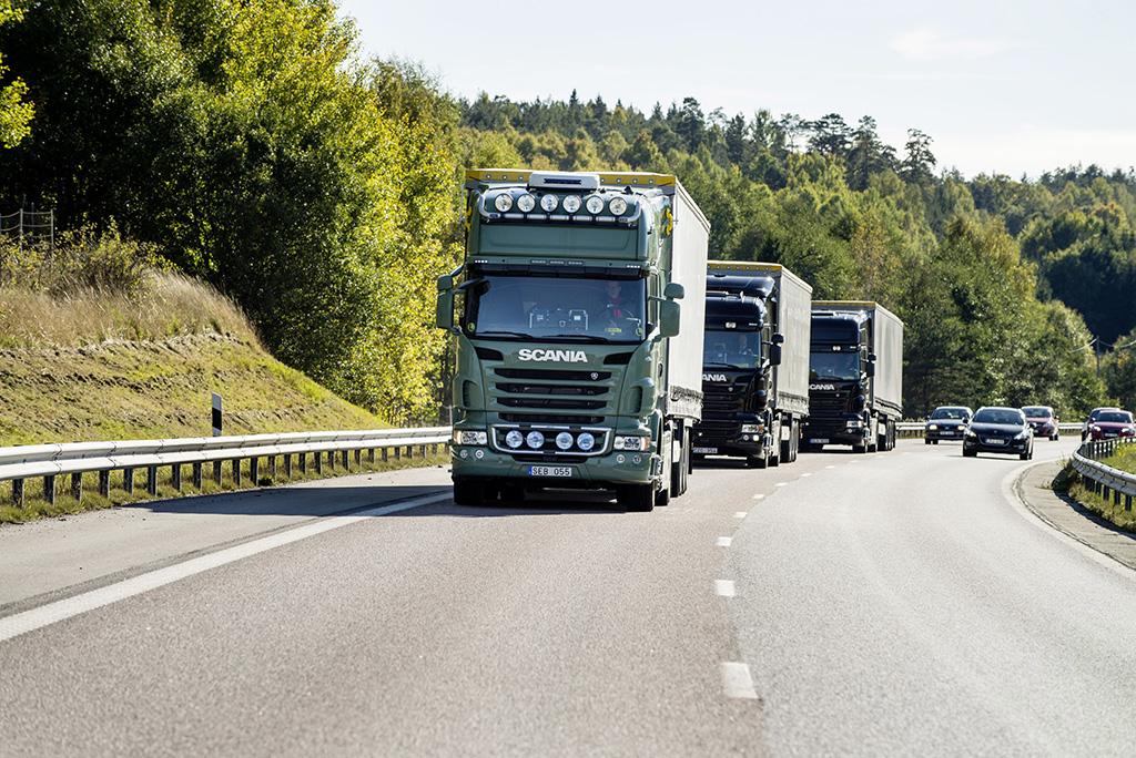 Volkswagen AG's Scania brand trucks drive on the road