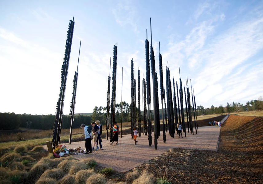 A side view of the face of Nelson Mandela spanning 50 steel columns