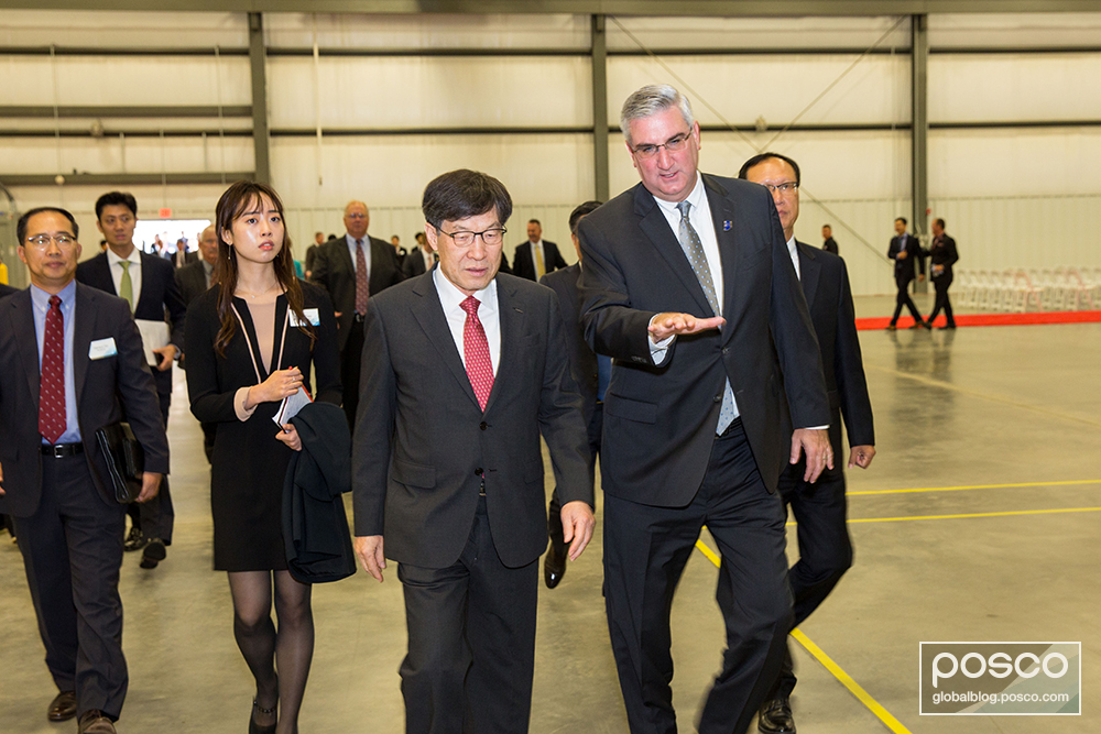 CEO Kwon and Indiana Governor Eric Holcomb browse the wire rod processing plant.