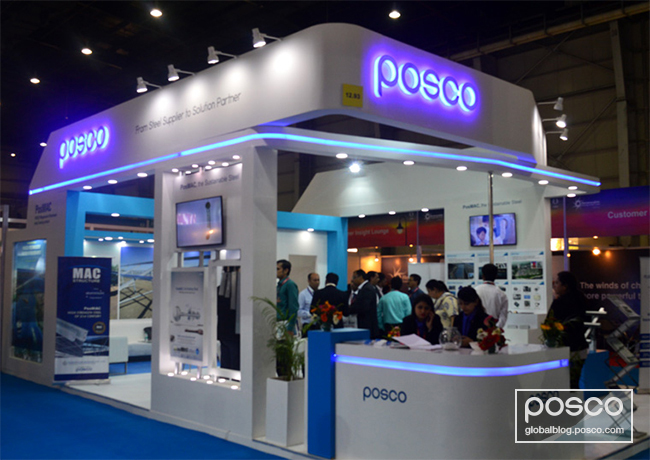 POSCO's Booth at the 2017 Renewable Energy India has numerous visitors learning about PV structures made of PosMAC steel.