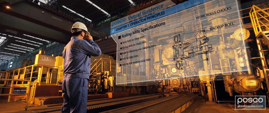 A worker looking at data in POSCO's smart factory.